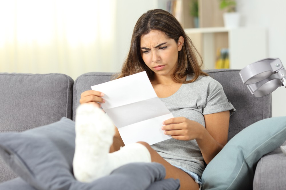 Woman reading radiology hospital bill