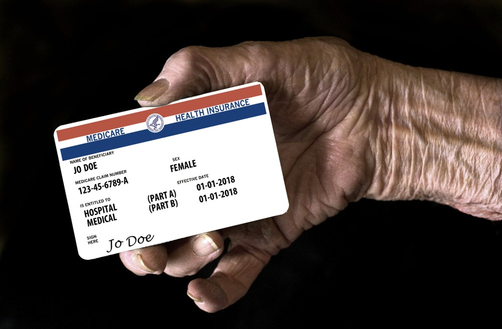 Radiology patient holding a health insurance card