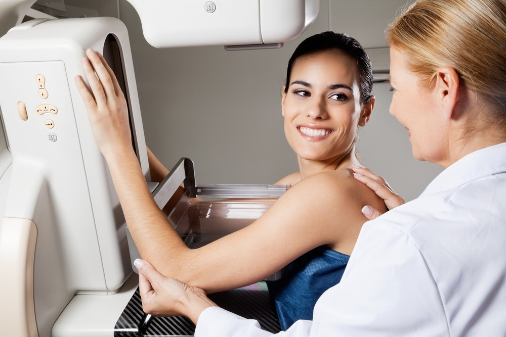 Female doctor is performing a mammogram on a young female|Info graphic of breast cancer awareness|Dr. Patricia Krakos - Make a Difference