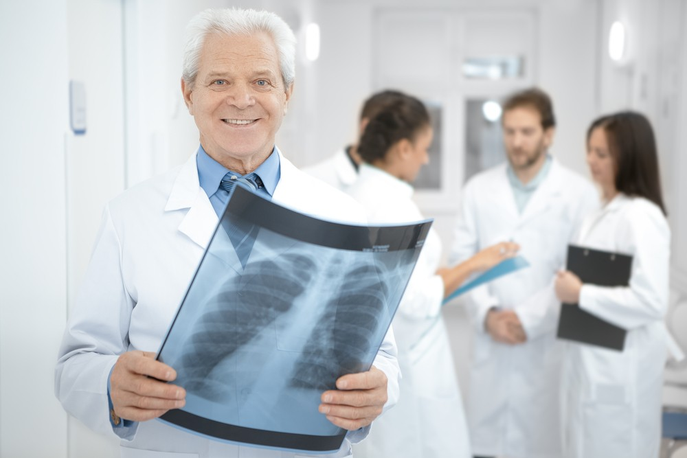 Protect Reimbursement Intervention Radiology Doctor holding x-ray image of chest